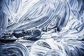 White Paint Over Dark Blue Glass