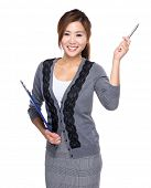 Woman with clipboard and pen point up