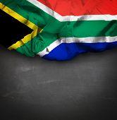 South Africa waving flag on blackboard