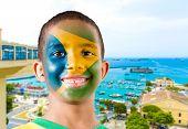 Little Brazilian boy painted the flag of Brazil in Salvador, Bahia.
