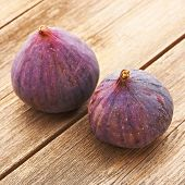 Fresh figs on rustic vintage wooden table