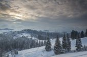 Winter landscape at sunset in mountains