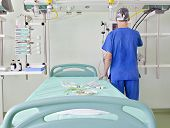Doctor Prepare Place In An Advanced, Modern Intensive Care Unit (icu) For Emergency Patients.