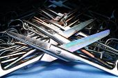 Row Of Used Metal Surgical Instruments