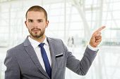 businessman pointing with his finger, at the office