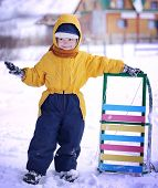 happy boy with sled outdoors