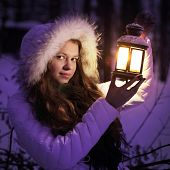 beautiful girl on winter forest with christmas  lantern