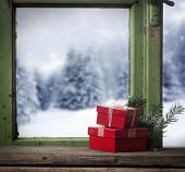 winter window and red gift boxes