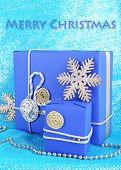 Dark blue gift boxes on blue fabric background