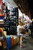 Tourists Shop For Bargain Priced Fashion And Casual Wear In Mong Kong Night Market
