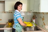 Woman Washing Dishes In Kitchen