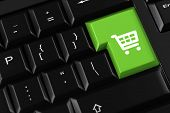 Shopping cart on a keyboard key as koncept for online shopping (3D Rendering)