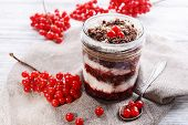 Delicious dessert in jar on table close-up