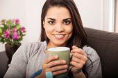 Cute Brunette Drinking Tea
