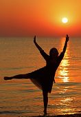 Girl Dancing On The Background Of Sunrise