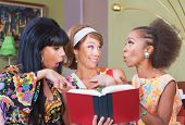 picture of tawdry  - Happy woman reading book with friends in 1960s fashion - JPG