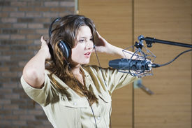 picture of recording studio  - Young beautiful retro woman recording the sound in professional studio with mic and phones - JPG