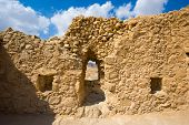 foto of masada  - Ancient wall with window in Masada in Israel - JPG