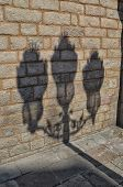 stock photo of lamp post  - Shadow of lamp post on the wall of church - JPG