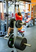 picture of barbell  - Barbell plates holder rack in the gym - JPG