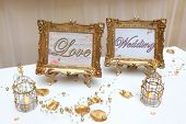 picture of descriptive  - Two Golden Frames with description Love and wedding - JPG