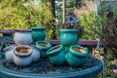 stock photo of planters  - Empty planters sit on a table waiting to be filled - JPG