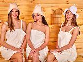 stock photo of sauna woman  - Group people  woman wearing hat in sauna - JPG