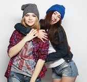 stock photo of crazy hat  - Fashion portrait of two stylish sexy hipster girls best friends - JPG