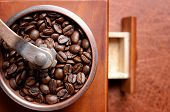 stock photo of spit-roast  - Freshly roasted coffee beans in the mill - JPG