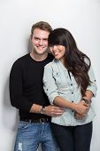 image of multicultural  - A portrait of a happy young multicultural couple - JPG