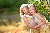 stock photo of sisters  - portrait of two sisters twins in tropical style - JPG