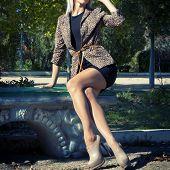 image of slender legs  - Fashion photo of beautiful slender girl model in leopard print jacket with sunglasses - JPG