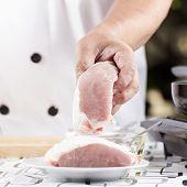 picture of pork  - Chef holding raw pork  - JPG