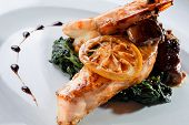picture of shrimp  - Salmon with mushroom sauce served on boiled spinach and shrimp - JPG
