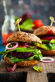 image of veggie burger  - Veggie beet and quinoa burger with avocado - JPG