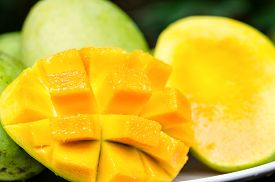 stock photo of mango  - Several ripe mango on a plate - JPG
