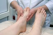 pic of massage therapy  - the masseur makes massage of legs in a massage - JPG