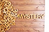 Постер, плакат: Word mystery made with wooden letters