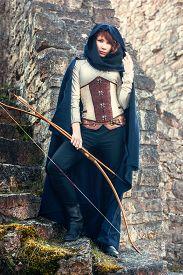 stock photo of bow arrow  - Ancient female archer with bow and arrow - JPG