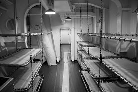 foto of battleship  - Tight sleeping quarters of a World War II era battleship - JPG