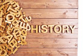 stock photo of piles  - Word history made with block wooden letters next to a pile of other letters over the wooden board surface composition - JPG