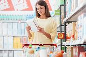 Woman Reading Food Labels poster