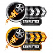 flaming racing tire on white and gold arrow banners