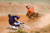 picture of dirt-bike  - Image of motocross participants on dirt bikes in action - JPG