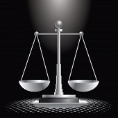 justice scales under spotlight