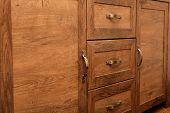 Close-up Detail Of High Quality Oak Wood Cabinets With Bronze Cabinet Hardware Drawer Pulls poster