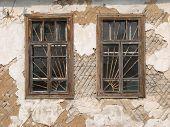 Two Aged Ruined Urban Windows