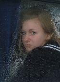 Girl Looks Thru Waterdropped Widow Glass 003