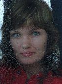 Girl Looks Thru Waterdropped Widow Glass 10