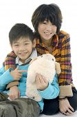 Young mother and son with toy cheep on white